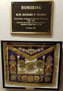MW Richard Thomas' Grand Master Apron mounted below his plaque in the second floor hallway.